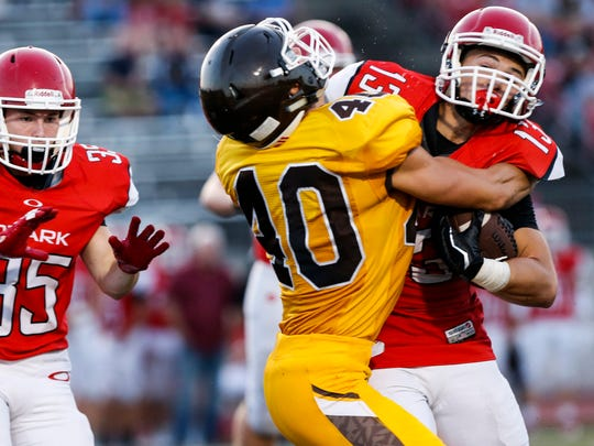 Skylr Lave (13), of Ozark, gets wrapped up by Andrew