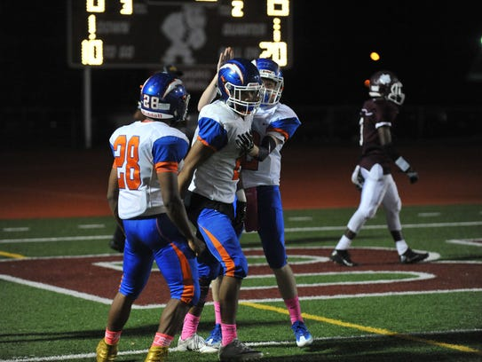 Millville's Marcial Ramos and Tristan Harris celebrate