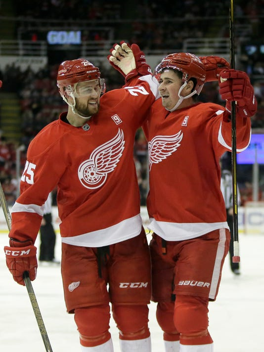 Detroit Red Wings center Dylan Larkin, right, celebrates his goal with defenseman Mike Green (25) during the second period of an NHL hockey game against the Columbus Blue Jackets, Friday, Dec. 9, 2016, in Detroit. (AP Photo/Duane Burleson)