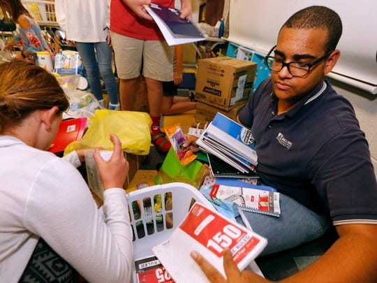 Central Magnet Student Sevon Askew, 11th grader, packs up donated items to be shipped to a school in the Florida Keys to help with hurricane relief, on Thursday Sept. 28, 2017.