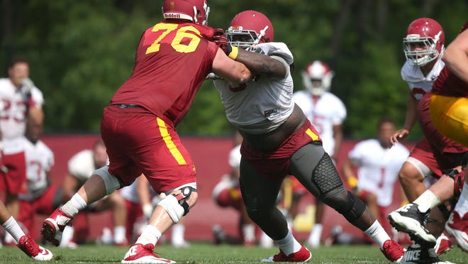 Iowa State senior offensive lineman Jamison Lalk and junior defensive tackle Demond Tucker practice on Friday, Aug. 7, 2015, at the Iowa State practice facility near Jack Trice Stadium in Ames, Iowa. With a season-ending injury to his backup, Lalk's health is even more important