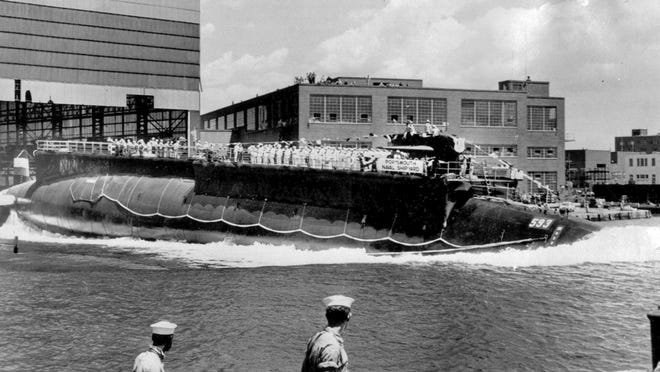 In this July 9, 1960, file photo, the U.S. Navy nuclear powered attack submarine USS Thresher is launched bow-first at the Portsmouth Navy Yard in Kittery, Maine. The Navy is releasing documents from the investigation into the deadliest submarine disaster in U.S. history. A judge ordered the release of the documents that pertain to the sinking of the USS Thresher 57 years ago, and the first batch was made public on Wednesday, Sept. 23, 2020.