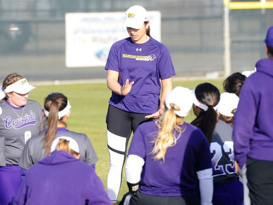 Hardin-Simmons coach Chanin Naudin talks to her team following a game during the 2018 season.