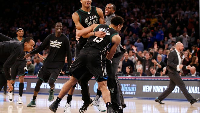 Malcolm Brogdon and Khris Middleton celebrate with Giannis Antetokounmpo after his buzzer-beater at Madison Square Garden in January.