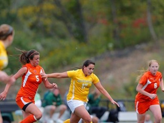 South Western grad Kimberly Vogan, center (#17), in action for Marywood women's soccer on Oct. 13 against Cenetary College. Vogan scored the game-winning goal in a 2-1 victory for the Pacers. (Photo by NJ Sport Pics)