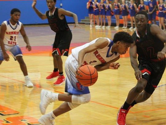 Central HIgh School's Deveraux Minix (2) had a team-high 15 points and four 3-pointers in a 77-74 overtime loss against Killeen Harker Heights at Babe Didrikson Gym on Tuesday, Jan. 2, 2018.
