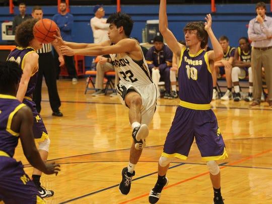 Brady High School's Gonzalo Morales (22) passes the