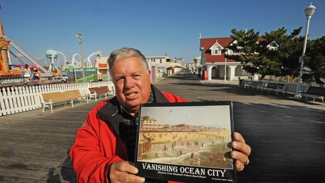 "Hunter ""Bunk"" Mann holds a copy of his book on the Boardwalk in Ocean City. The author spent eight years doing research on the book that's rapidly becoming a runaway best-seller."