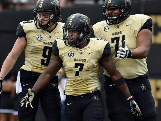 Vanderbilt running back Ralph Webb (7) reacts to scoring