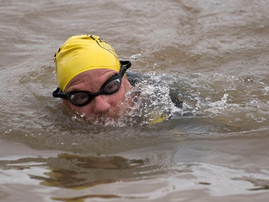 Brian Bischoff on a mile-long swim in Fort Loudoun Lake on Thursday.