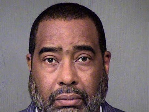 Booking mugshot released Thursday, Dec. 12, 2013, by the Maricopa County Sheriff's Office of Earl Dennison Woods Jr., who was arrested for calling in a fake bomb threat. He is Tiger Woods' half brother.