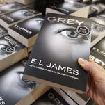 """Copies of """"Grey"""" by British writer EL James are on display on a bookshop in central London."""