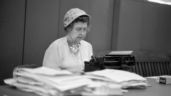 Ione Quinby Griggs, the longtime advice columnist at The Milwaukee Journal, sits down at the typewriter in the Journal newsroom in this undated photo, probably from the late 1950s.