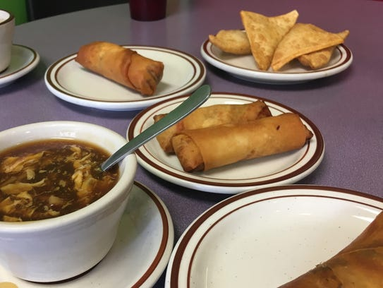 The hot and spicy soup, pork and bacon egg rolls, chicken
