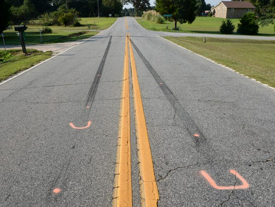 Skid marks and paint mark Flat Rock Road in Starr,
