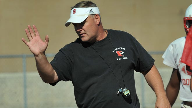 Southport football coach Bill Peebles instructs players during practice Tuesday October 8, 2013. Joe Vitti / The Star