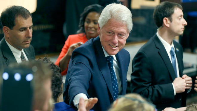 Bill Clinton shakes hands with supporters of his wife Hillary at Laborer's Union Local 435 in Rochester.