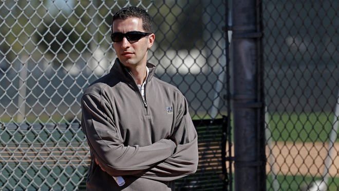 Milwaukee Brewers general manager David Stearns watches a drill during a spring training baseball workout in 2016.