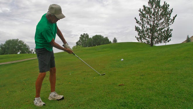 Pete McKinnon aims a shot for the green during a round Thursday at the Aztec municipal golf course.