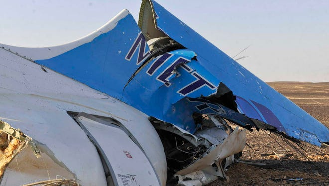 The tail of a Metrojet plane that crashed in Hassana, Egypt, on Oct. 31, 2015, is shown in a picture released by the Egyptian prime minister's office.
