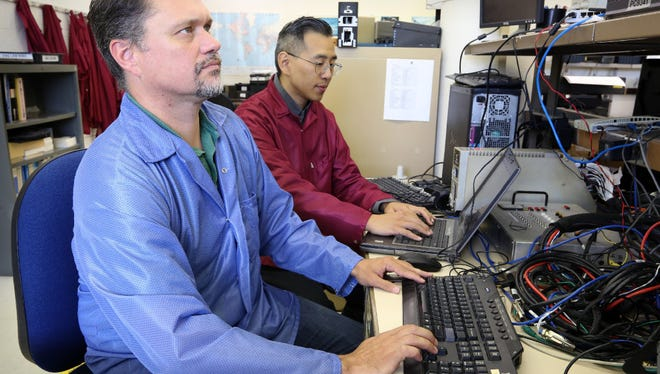 David Jones (left) and Elijah Liu, both engineers at Astronautics Corporation of America, begin work on an FAA contract to develop a comprehensive approach to identify and address aircraft cybersecurity threats.