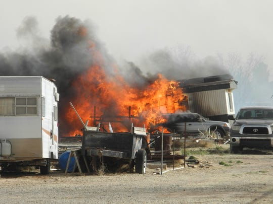 Flames engulf a home and other structures and vehicles in Artesia on Feb. 28.
