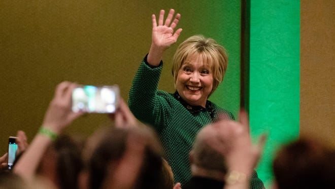 Hillary Clinton waves as she arrives at the Society of Irish Women's annual dinner on St. Patrick's Day in her late father's hometown in Scranton, Pa., on March 17, 2017.