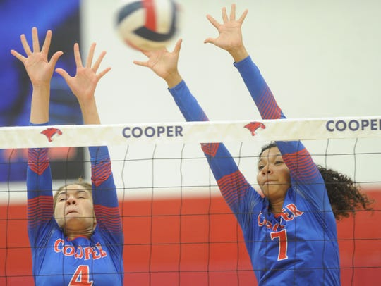 Cooper's Alexis Garcia (4) and Diamond Brown (7) defend