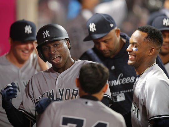 New York Yankees' Didi Gregorius, second from left, celebrates his home run with teammates during the 10th inning of a baseball game against the Los Angeles Angels, Friday, April 27, 2018, in Anaheim, Calif.