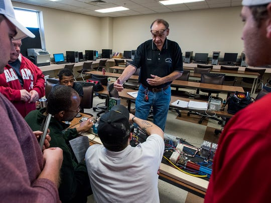 Trenholm instructor Ralph Burton works with students