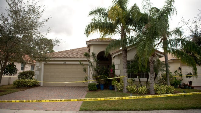 Images from outside a home on the 1100 block of Southeast Fleming Way in Martin County on Nov. 7, 2016, where a woman and man were found dead by apparent gunshot wounds.