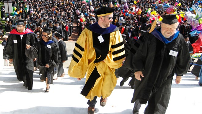 University of Virginia College of Arts and Sciences faculty lead students up the steps as commencement exercises begin. Education has been found to help recovery from brain injuries.
