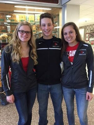 Colerain's Kerry Tepe, left, Joel Dennis and Hailee Trotter represented the Cardinals at the Division I state swim meet in Canton Feb. 26-27.