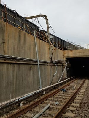 This downed pole near the Ferry Avenue station caused PATCO to stop all service Monday morning.