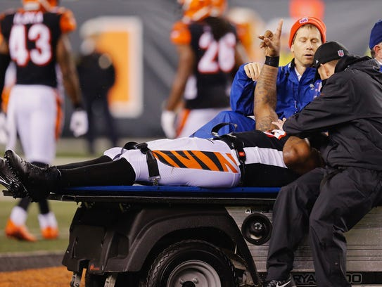 Vontaze Burfict is loaded on to the cart.