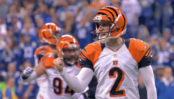 Bengals kicker Mike Nugent celebrates his field goal at the end of the first half  at Lucas Oil Stadium in Indianapolis during SundayÕs AFC Division Playoff between the Cincinnati Bengals and Indianapolis Colts.