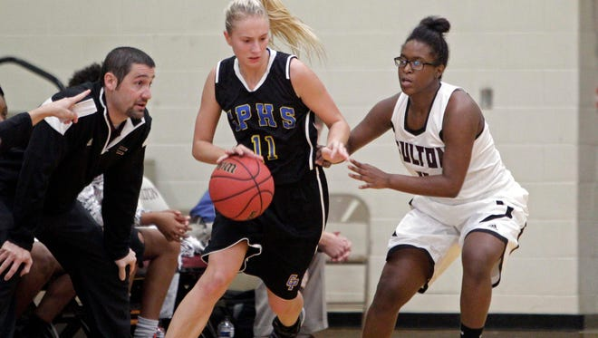 Gatlinburg-Pittman's Rylie Patterson drives against Fulton's Tilia Tinsley during a game in 2015. Patterson scored 21 points to help G-P win the Smoky Mountain Classic on Friday.