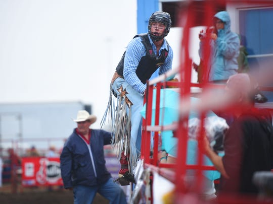 PRCA bull rider Ryan Knutson looks back at the bull he got thrown off of after his ride.