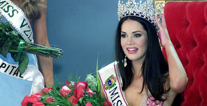 Venezuelan Monica Spear poses after being elected Miss Venezuela, in Caracas, on Sept. 23, 2004. She and her spouse were shot to death earlier this year.