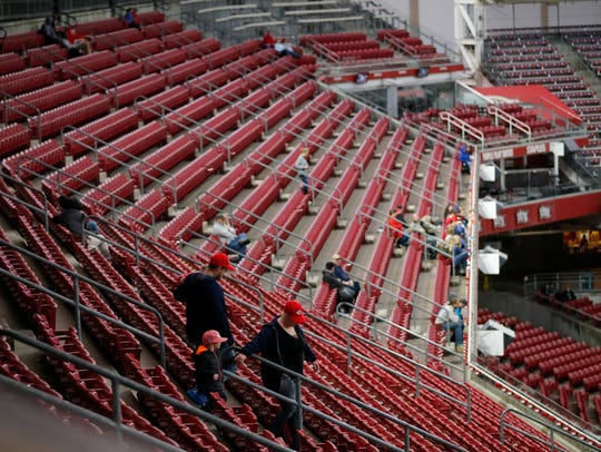 A family find its seats in the upper deck during the
