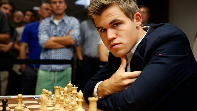 Magnus Carlsen, of Norway, pauses during a match in the sixth round of the Sinquefield Cup chess tournament on Tuesday, Sept. 2, 2014, in St. Louis.