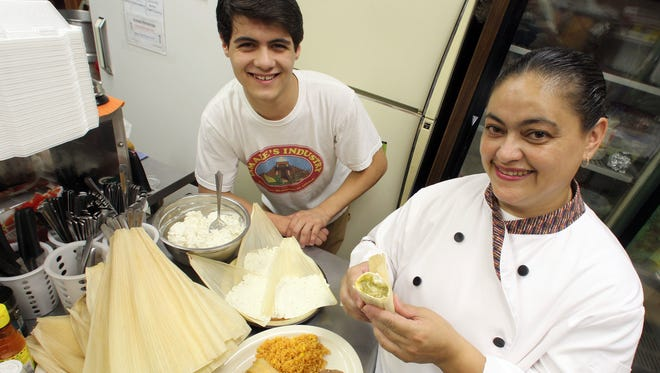 Chef Angelica Tejeda, right, and her son, Gabriel, her marketing manager, at Tamale's Industry in Des Moines. The restaurant is moving from Second Avenue to Merle Hay Mall.