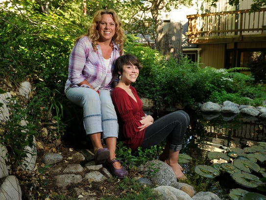 Shannon Quishenberry, on the left, sits with her teen