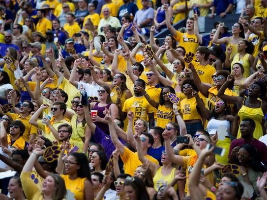 The LSU Tigers face the Auburn Tigers in an NCAA football