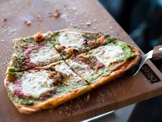 Crust's The God Mother features ricotta pesto, bacon,