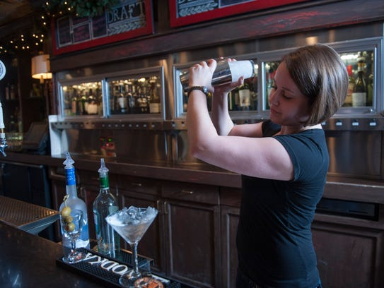 Bartender Melissa Canavan makes a martini with Grey