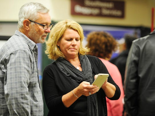 Kim Mahaney, of Nashville, right, shows her husband