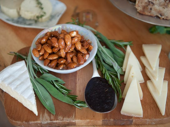 Candied almonds and cheese plate, part of the holiday
