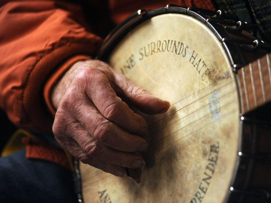 A closeup of Pete Seeger and his banjo during an interview