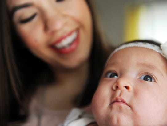 Karen Garibaldo with baby Victoria at home in Prunedale,